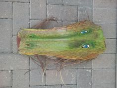 Dragon I painted on a palm frond.