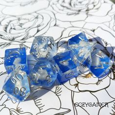 Swanderful. White Swan dice set. Miniature white swans on a layer of deep bright blue