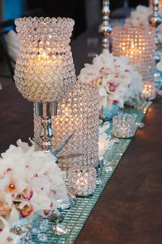 Weddings candles -  Embellished candle holders add endless amounts of bling when paired with silver, blue and pink #weddings#table-settings#candles