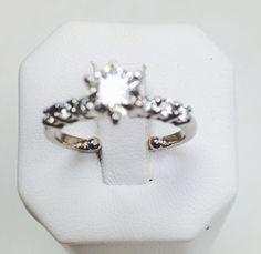 New diamond set in customer's original engagement ring.