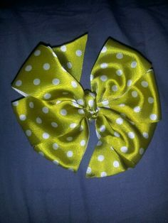 Green with white polka dots pinwheel bow. $2 on beccas little designs on facebook.