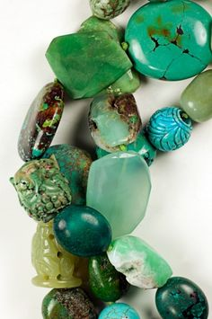 Monies Turquoise, Jade, Agate, Chrysoprase Necklace. Large, smooth chunks of Turquoise, Jade, Agate and Chrysoprase hang from a 3 strand design. Completely dramatic and organic. Material: Turquoise, Jade, Agate, Chrysoprase, Leather Color: Green Length: 1
