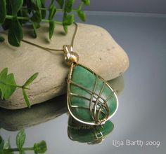 Free Wire Jewelry Tutorials | Criss Cross Wire Wrapped Pendant Tutorial | JewelryLessons.com