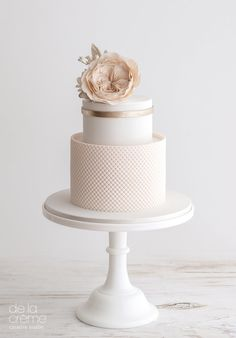 Blush pink textured wedding cake | by De La Creme