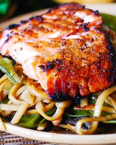 Easy, delicious, super flavorful Asian Salmon and Noodles make an excellent weeknight dinner choice. Easy to make and they will bring a variety to your weekly rotation of recipes. Honey-soy salmon broiled to perfection and Salmon Dishes, Fish Dishes, Seafood Dishes, Fish And Seafood, Seafood Recipes, Beef Recipes, Dinner Recipes, Cooking Recipes, Healthy Recipes