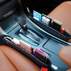 car gadgets No more dropping of small items and digging it in between your car seat and console. This Car Seat Pocket was designed to perfectly fit unused spaces between your car seats and provide extra storage with easy accessibility. Car Interior Accessories, Car Interior Decor, Cute Car Accessories, Vehicle Accessories, Car Interior Design, Luxury Interior, Maserati, Bugatti, Car Storage Box