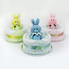 Bath Time Range  The bath time nappy cake is an adorable gift for the arrival of a new baby or as a baby shower gift.  Each cake is presented with a super soft Bunny holding a gorgeous arrangement of face washer flowers.