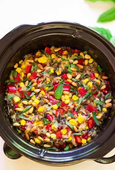 Easy Slow Cooker Wild Rice Pilaf with Basil, Corn and Bell Pepper. A summer spin on classic pilaf that's perfect for barbecues and easy dinners. No oven!