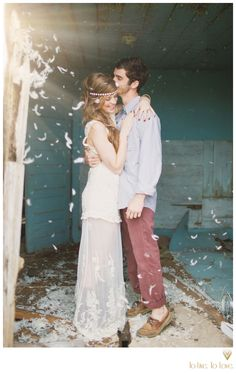 What about tossing feathers instead of petals for the flower girl, or after we walk down the isle? Sparklers can always be for first dance of for when the wedding party enters the reception.