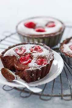 Make these delicious chocolate tarts with fresh raspberries, served with a dollop of cream. Try making the chocolate pastry yourself, or if you're rushed for time, pre-made ones work just as well. | Tesco