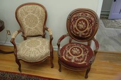 "Pair of Victorian arm chairs, 1 with needlepoint upholstery and 1 on casters 28""x27""x40"""