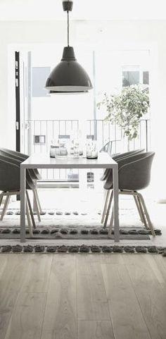 = black pendants, wood floor and rug