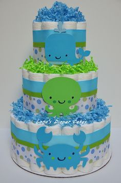 Blue And Green Under The Sea Diaper Cake Baby Shower Centerpiece by LanasDiaperCakeShop on Etsy https://www.etsy.com/listing/155983188/blue-and-green-under-the-sea-diaper-cake