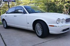 2006 Jaguar XJ8 Vanden Plas. White with ivory interior. 77,000 miles. This is the luxury version of the XJ8, with an extra 4 inches of legroom in the back, soft upgraded leather seats, and virtually...