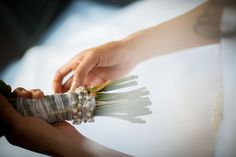 Wrap your bouquet with a charm or rosary. Photo by Foskett Creative