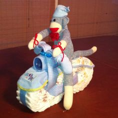 "The diaper cake Robin made for Jessica's shower.  Being ridden by ""ape boy"""