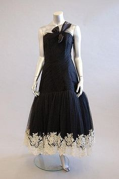A Lanvin/Castillo couture evening gown, late 1950s. Love the ivory lace on navy at the hem.