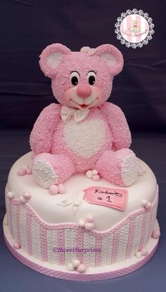 The teddy is made out of rice chrispies. I used grated sugarpaste for the fur.. Thanks for looking :-)