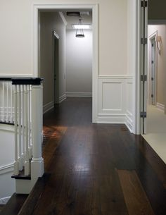 Species:  Estate™ Collection, European Smoked Black Oak Character grade floor  Size:  7-1/4″ wide  Color:  Natural Color  Finish:  Poloplaz Supreme Polyurethane Oil, Satin sheen  The natural deep dark brown color of the Smoked Black Oak has beautifully complimented this North Shore home décor
