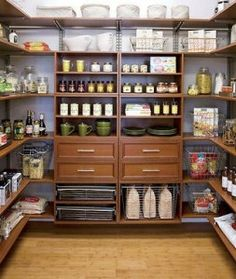 I love this pantry. Clean, simple, organized, love the wooden shelves and drawers!