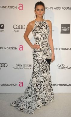 Nina Dobrev wearing a Naeem Khan dress, Chopard jewellery and Swarovski clutch arrives to the Elton Johns AIDS Foundation Oscars Party 2013.