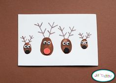 """Family thumb print Christmas cards! How fun are these? Could you get your kids to do a whole card list's worth, though? Maybe more of a """"make it and frame it for Grandma"""" idea. #holidays #christmas #cards #kids #crafts"""