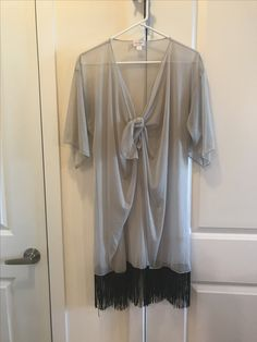 Looks great w/ long tunic under, skinny jeans and tall heels
