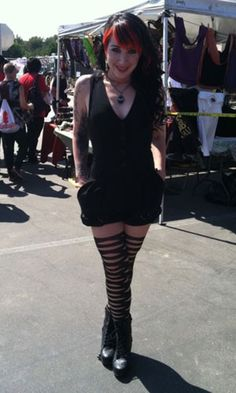 While at Warped Tour, Ash Costello wore the Wolford Fabric Ribbon Tights, Jeffrey Campbell Lita shoes in black distressed leather, Gasoline Glamour Jet Rhinestones Bat Necklace and a Zara jumper.