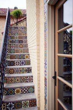 mediterranean staircase by English Heritage Homes of Texas Azulejos variados en la escalera junto al muro de la casa.