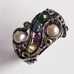 "©Kristine Schroeder, ""Theodora"", size 6 ring in cultured pearl, yellow sapphire, ruby, emerald, sapphire."