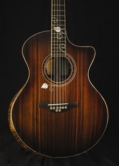 Stehr small jumbo acoustic guitar - sinker redwood top, venetian cutaway, leaf inlay, and unique rosette