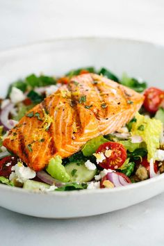Salmon Greek Salad with Lemon Basil Dressing - A light and healthy recipe that tastes amazing! Crisp vegetables are tossed in a tangy lemon basil dressing and topped with flaky salmon. Salmon Salad Recipes, Greek Salad Recipes, Summer Salad Recipes, Summer Salads, Summer Grilling Recipes, Healthy Grilling, Seafood Recipes, Cooking Recipes, Healthy Recipes