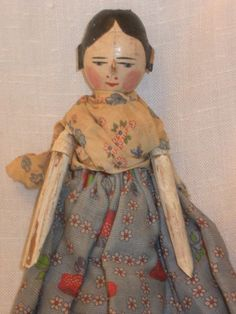 Circa 1800s. Early Wood Penny Doll. the clothes are not original.added later. and leather band to attach the arms. | eBay!