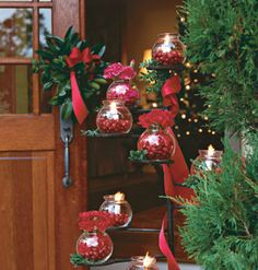Glowing Greetings--Transform everyday household items into a welcoming outdoor candlescape. Here, a plant stand doubles as a tall candelabra, with flames and flowers confined in small, inexpensive fishbowls.