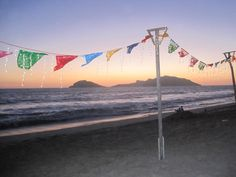 Banderines or Mexican paper flags strung between poles, along with Christmas lights, make for good beach party decorations and lighting.