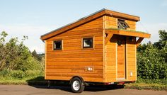ShelterWise's 96 sq. Salsa Box Tiny House on wheels. A cozy and compact micro home for simple living and occasional traveling because it's an easy to tow tiny home. The one you're seeing here is the model but it's also available in and lengths. Home Modern, Modern Tiny House, Tiny House Living, Tiny House Design, Building A Tiny House, Tiny House Plans, Tiny House On Wheels, Green Building, Building Plans