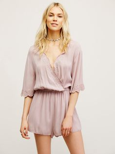 Zelma Romper   In a crinkly fabric this lightweight romper features a plunging surplice V-neckline with tonal embroidery detailing and a scalloped trim. Elastic waistband for an easy fit.