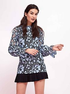 This mod 60s-inspired shift dress in a black and blue floral lace features a cute black ruffle skirt and cinched poet sleeves for an easy summer party fix. ...