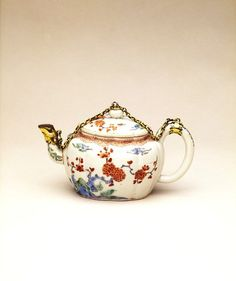 Arita, Japan (teapot, made)      Europe (mounts, made)      Date:        1680-1700 (made)      Artist/Maker:        Unknown (production)      Materials and Techniques:        Porcelain, with Kakiemon-style decoration, and silver-gilt mounts