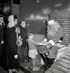 December 1942.  New York.  R. H. Macy & Company department store the week before Christmas.  Children line us to talk with Santa Claus.