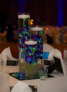 I would lose the clear rocks and maybe add a small led at tge bottom to creat a warm glow. Or keep the candles This is a very peacock looking centerpiece Purple Wedding, Wedding Colors, Diy Wedding, Wedding Flowers, Dream Wedding, Wedding Ideas, Peacock Themed Wedding, Wedding Things, Wedding Table