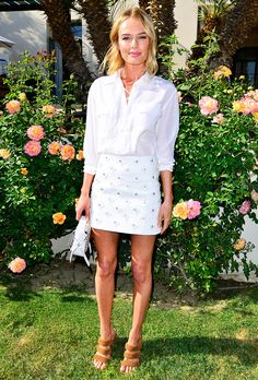 Kate Bosworth in a white button-down blouse tucked into a white embellished skirt and tan heels // Coachella 2015