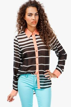Earn your fashion stripes with this contemporary yet feminine blouse. Colored collar and cuffs update this chiffon blouse and give it a subtle, but fun pop of color. Front button closure. Hi-low silhouette. BOUTIQUE FIVE.