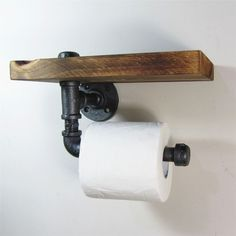 Add a little Industrial/Urban chic to your bathroom Combining a handy wooden shelf and using iron pipes to make the sturdy roll holder. Made from natural grained wood so each piece is unique. - Size: 9.4 in x 5.9 in .