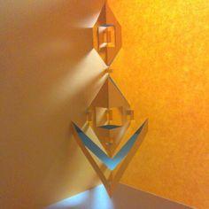 Dobleces paralelos al eje de simetría, niveles de volumen