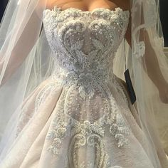 This strapless a-line style ball gown can be recreated for you in any size. Since we are custom dress makers we can make all types of #weddingdresses for you with any design changes. We are also able to make really close #replicas of haute couture designer dresses. So if your dream dress is too pricey for your budget we can help! DariusCordell.com
