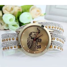 White wrap around Elephant Watch NWOT wrap around elephant watch with snap buckle closure.                                                             more colors available Accessories Watches