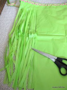 Grass skirt - made from a plastic table cloth....hmmmm, could I make Spider-girl skirts for the girls for Will's party out of red and blue tablecloths?