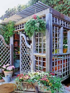 Wonderful garden shed...I hate to call it a shed....so pretty!