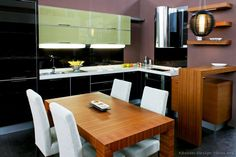 #Kitchen of the Day: Modern Two-Tone Kitchens. Elegant, two tone black green medium wood zebrawood table
